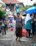 A woman carrying goods at market in Bali, Indonesia Stock Photography