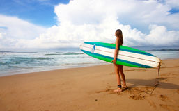 Woman Carrying Green Blue and White Surfboard during Daytime Royalty Free Stock Photography