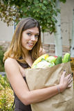 Woman carrying groceries Stock Image