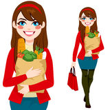 Woman Carrying Grocery Bag Royalty Free Stock Photography