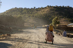 Woman carrying a heavy load, Ethiopia Royalty Free Stock Photos
