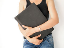 Woman carrying her laptop Royalty Free Stock Images