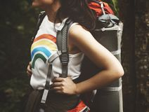 Woman Carrying Hiking Backpack Standing Under Shade of Tree royalty free stock image