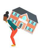Woman carrying house. Royalty Free Stock Images