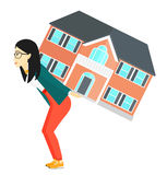 Woman carrying house. Stock Photo