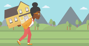Woman carrying house vector illustration. Royalty Free Stock Image