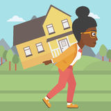 Woman carrying house vector illustration. Royalty Free Stock Photography
