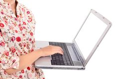 Woman carrying a laptop Royalty Free Stock Photography