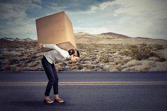 Woman carrying a large box Royalty Free Stock Images