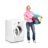 Woman carrying a laundry basket Stock Photography