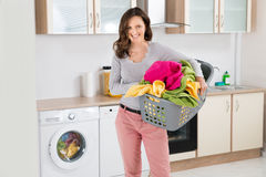Woman Carrying Laundry Basket Stock Image