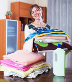 Woman carrying laundry to iron Stock Photo