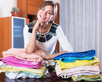 Woman carrying laundry to iron Royalty Free Stock Photos