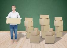 Woman carrying and lifting boxes stock photography