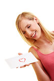 Woman carrying a love letter Royalty Free Stock Image