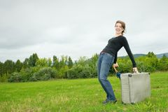Woman carrying a luggage Stock Image