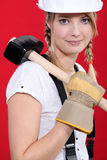 Woman carrying a mallet Royalty Free Stock Images