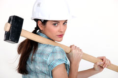 Woman carrying a mallet Stock Image