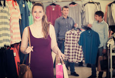 Woman carrying many paper bags with purchase Royalty Free Stock Image