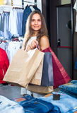 Woman carrying many paper bags Royalty Free Stock Photo