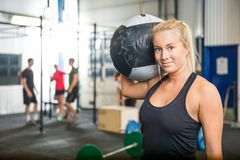 Woman Carrying Medicine Ball At Crossfit Gym Stock Images