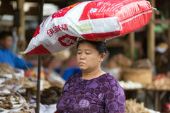 Woman carrying monosodium glutamate bag Royalty Free Stock Photography