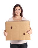 Woman carrying moving box Stock Image