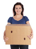 Woman carrying moving box Royalty Free Stock Photos