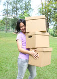Woman carrying moving boxes Royalty Free Stock Image
