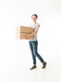 Woman carrying moving boxes. Young cauacsian woman carrying moving boxes, on white background Stock Photography