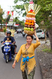 Woman carrying offerings Stock Photos
