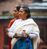 Woman carrying offerings Nepal royalty free stock photography