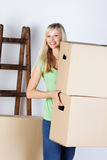 Woman carrying packing cartons Royalty Free Stock Images
