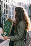 Woman Carrying Paper Bag stock photo