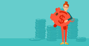 Woman carrying piggy bank. Royalty Free Stock Image