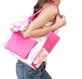A woman carrying a pink handbag Stock Images