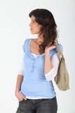 Woman carrying a purse Royalty Free Stock Images