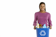 Woman Carrying Recycling Bin Stock Image