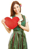 Woman carrying red heart as symbol Stock Photo