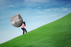 Woman carrying rock with persistence word Royalty Free Stock Image