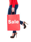 Woman Carrying Sale Shopping Bag. Close-up of Young Woman Carrying Shopping Bag with Sale Sign Isolated on White Stock Photo