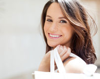 Woman carrying shopping Stock Photography