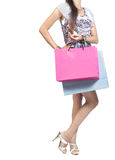 Woman carrying shopping bag. View of woman carrying shopping bag. isolated over white background Stock Photography