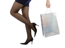 Woman carrying shopping bag. Isolated on white background Royalty Free Stock Image
