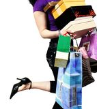 Woman carrying shopping bag. Waist-down view of woman carrying shopping bag Royalty Free Stock Images