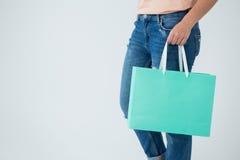 Woman carrying shopping bag Stock Photo
