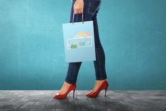 Woman carrying shopping bag with Monsoon sale sign. Monsoon sale concept Royalty Free Stock Images