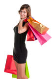Woman Carrying Shopping Bags. Isolated in a white background Royalty Free Stock Photo