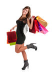 Woman Carrying Shopping Bags. Isolated in a white background Stock Photography