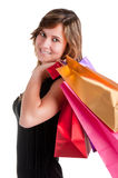 Woman Carrying Shopping Bags. Isolated in a white background Stock Photo
